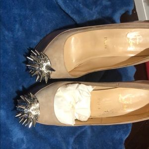 christian louboutin nude high heels with spikes